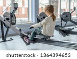 little girl in the gym rowing... | Shutterstock . vector #1364394653
