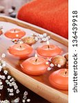 beautiful candles in water on... | Shutterstock . vector #136439918
