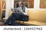 man reading newspaper in the... | Shutterstock . vector #1364527463