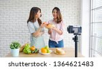 two young asian women food... | Shutterstock . vector #1364621483