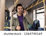 young man listening to music... | Shutterstock . vector #1364740169