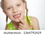 a child without teeth  | Shutterstock . vector #1364792429