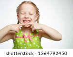 a child without teeth  | Shutterstock . vector #1364792450