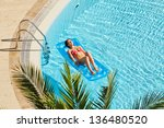 young woman in red swimsuit... | Shutterstock . vector #136480520