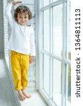 child measures height  | Shutterstock . vector #1364811113