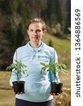 woman gardener holding her... | Shutterstock . vector #1364886569