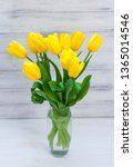 bouquet of yellow tulips in a... | Shutterstock . vector #1365014546