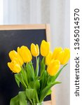 a bouquet of yellow tulips on a ... | Shutterstock . vector #1365014570