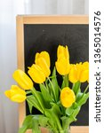 a bouquet of yellow tulips on a ... | Shutterstock . vector #1365014576