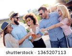 group of young friends having... | Shutterstock . vector #1365207113
