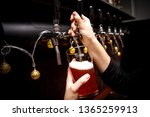 bartender pours fresh ale from... | Shutterstock . vector #1365259913