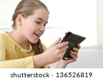 young pretty girl in a yellow... | Shutterstock . vector #136526819