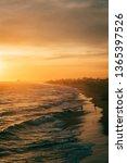 vibrant sunset over the beach...   Shutterstock . vector #1365397526
