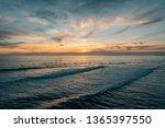 sunset over the pacific ocean ...   Shutterstock . vector #1365397550