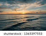 sunset over the pacific ocean ...   Shutterstock . vector #1365397553