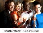 group of friends enjoying... | Shutterstock . vector #136543850