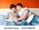 pregnant mother and her husband | Shutterstock . vector #136548830