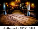 Stock photo desk of free space and blurred background of bar 1365510323