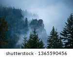 mist rising from valleys in... | Shutterstock . vector #1365590456