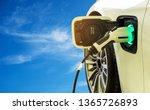 ev car or electric car at... | Shutterstock . vector #1365726893