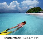 young lady snorkeling in a... | Shutterstock . vector #136574444