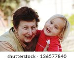 grandmother and granddaughter | Shutterstock . vector #136577840