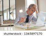 Stressed Businessman Working In ...