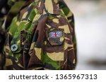 British flag on army camouflage uniform - stock photo