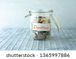 coins in glass money jar with... | Shutterstock . vector #1365997886