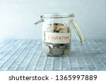 coins in glass money jar with... | Shutterstock . vector #1365997889