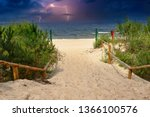 empty beach by the sea and a... | Shutterstock . vector #1366100576