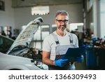 worker holding service list in... | Shutterstock . vector #1366309493