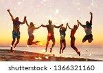 friends jumping on beach at... | Shutterstock . vector #1366321160