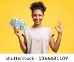 Smiling Girl Shows Money Cash...