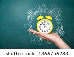 hand holds clock time minute... | Shutterstock . vector #1366756283