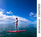 stand up paddle boarder... | Shutterstock . vector #136695830