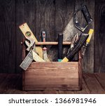 grungy old tools on a wooden... | Shutterstock . vector #1366981946