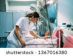 Small photo of Female doctor examining newborn baby in the hospital. Night shift