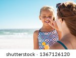 young mother applying... | Shutterstock . vector #1367126120