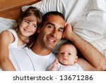 a father relaxing in bed with... | Shutterstock . vector #13671286