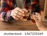 man and woman clinking glasses... | Shutterstock . vector #1367235269