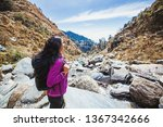 beautiful woman trekking alone... | Shutterstock . vector #1367342666