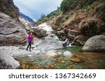beautiful woman trekking alone... | Shutterstock . vector #1367342669