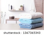 Stack Of Fresh Towels On Table...