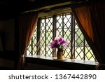 Vase Of Flowers By The Window.