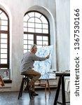 spacious workroom. grey haired... | Shutterstock . vector #1367530166
