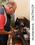 senior man using industrial... | Shutterstock . vector #136754129