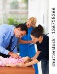 caring medical doctor examining ... | Shutterstock . vector #136758266