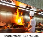 chef in restaurant kitchen at... | Shutterstock . vector #136758986
