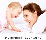 Stock photo mother and baby playing and laughing mom with her child happy family 136763546